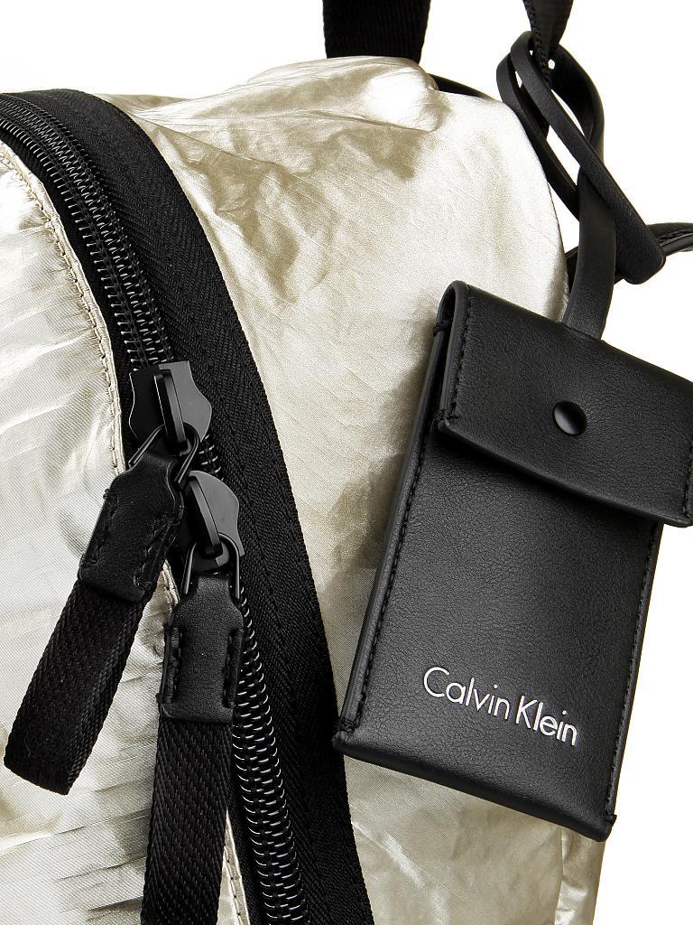 calvin klein rucksack gold. Black Bedroom Furniture Sets. Home Design Ideas